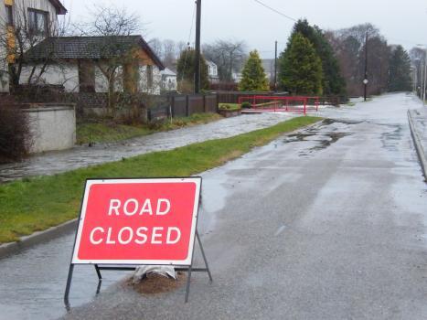 Flooding across a road